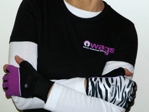 An image of someone wearing two different fitness WAGs gloves that help you deal with wrist pain